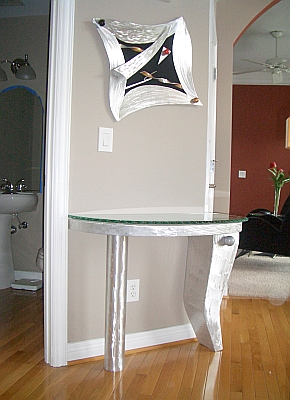 foyer table and art piece in aluminum