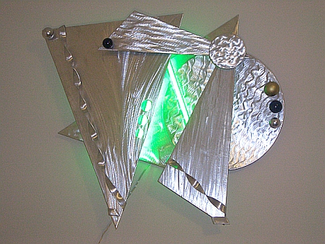 neon wall sculpture in green neon and brushed aluminum and neon artist, neon,neon art