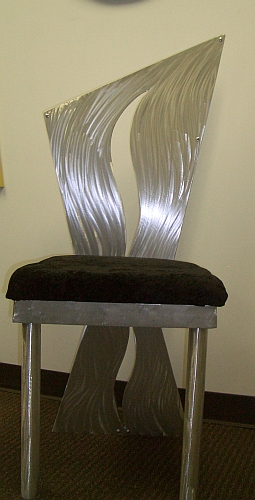 ding chair in abstract chair design in brushed aluminum