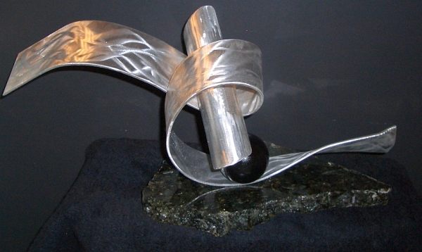 tabletop sculpture in modern abstract sculpture design in aluminum and granite