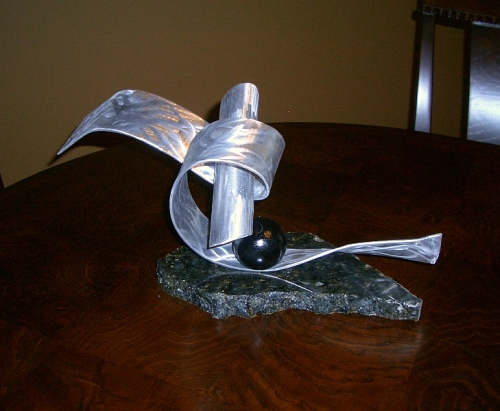 tabletop sculpture in aluminum and granite base, abstract sculpture designed in contemporary style
